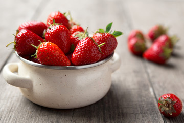 freshly picked strawberries in the bowl.