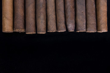 cigars on black background