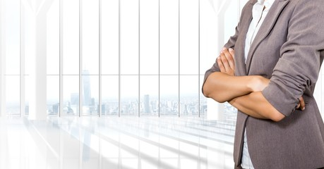 Business woman with blazer and her hands folded in the office