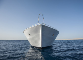 Bow of large motor yacht at sea