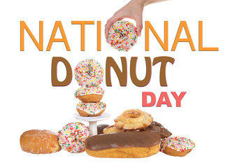 Variety of Donuts isolated on white background, National Donut Day in June and November. Hand holding donut for O in National and stacked donut for O in Donut.