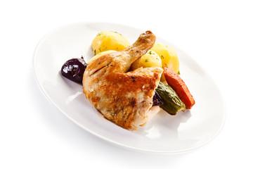 Roast chicken leg with potatoes