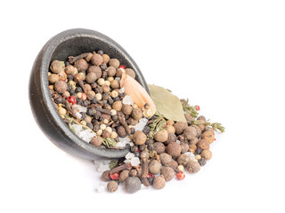 Fototapeta Group of Dry Spices with Thyme and Black Pepper Scattered out of the Black Bowl obraz