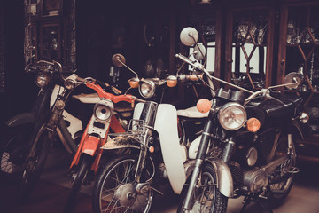 Old and Classic motorcycle parked in garage. Vintage color tone effect.