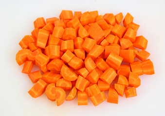 Chopped and sliced carrot on white plate