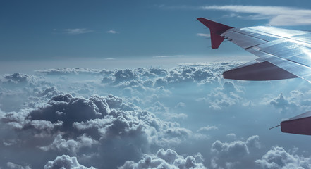 Aircraft wing and cloud vivid sky scenery.