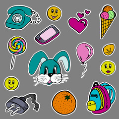 A set of fashion labels, badges. Hare, orange, smilies, old phone, mobile phone, heart, jack, balloon, egg, backpack, ice cream