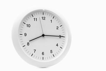 Ordinary White Kitchen Clock against White
