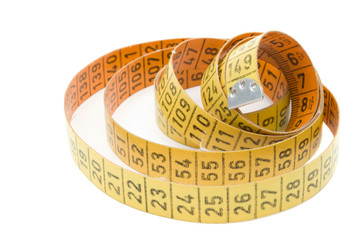Yellow and Orange Measurement Tape against White