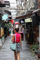 Chinese woman walking in Shanghai shopping street