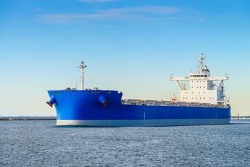 Cargo ship heading to open sea