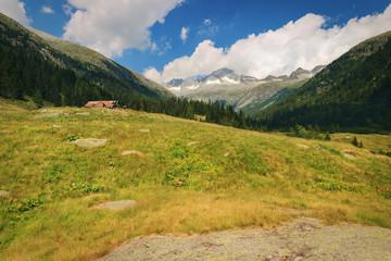 Old hut and Peak of Care Alto (3462 m) in the National Park of Adamello Brenta from the Val di Fumo. Trentino Alto Adige, Italy