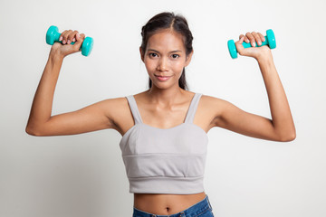 Healthy Asian woman with dumbbells.