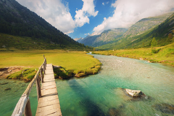 Footbridge over the Chiese river and in the National Park of Adamello Brenta from the Val di Fumo. Trentino Alto Adige, Italy