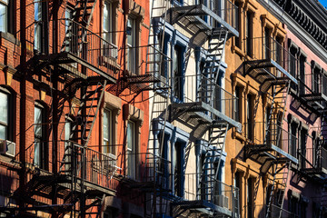 Colorful Soho building facades with painted fire escapes. Manhattan, New York City