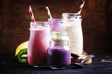 Selection of colorful berry and fruit smoothies and milkshakes, selective focus