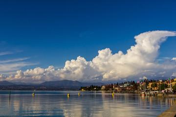 A placid lake reflecting clouds, Lake Garda
