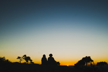 Two girls silhouettes at sunrise in Brazil
