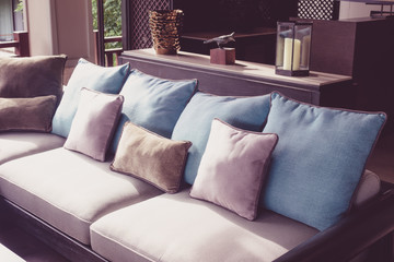 Closeup of modern furniture with pillows . ( Filtered image processed vintage effect. )