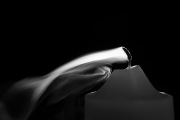 Smoke from a red candle - black and white