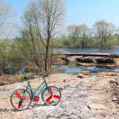 Old bicycle on off road terrain near the river
