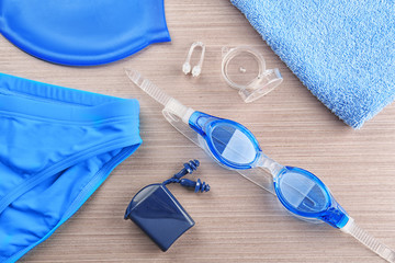 Accessories for swimming on wooden background