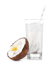 Glass of coconut water and fresh nut on white background