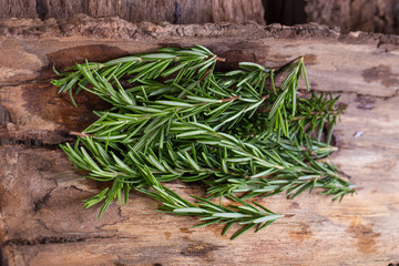 rosemary Herbs and Medicinal herbs. Organic healing herbs. fresh rosemary bunch rosemary on wooden background
