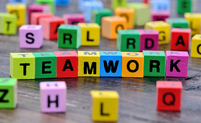 The word Teamwork on table
