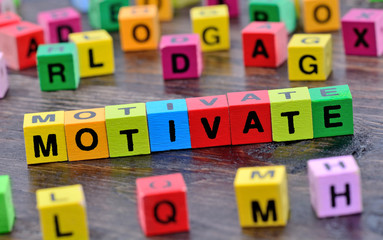 Motivate word on table