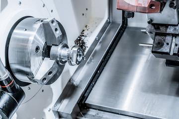 A modern CNC machining center processes the part.