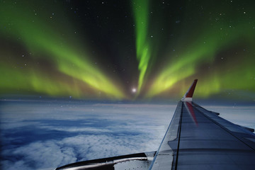 Aerial view of Northern Lights (Aurora Borealis) from window of an flying airplane