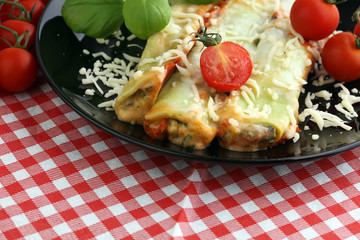 Baked cannelloni with minced meat and bechamel sauce on a plate. Italian cuisine