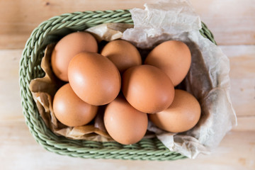 Raw chicken eggs in basket top view