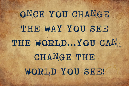 Inspiring motivation quote of once you change the way you see the world...you can change the world you see with typewriter text. Distressed Old Paper with Typing image.