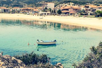 Boat on Kalamitsi beach. Kalamitsi is a romantic gateway for families, couples and adventurers. Location: Sitonia, Halkidiki, Macedonia, Northern Greece.