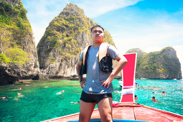 Happy young traveling on boat, Krabi Thailand