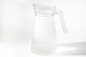 Jug of water with shadow and selective focus