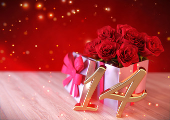 birthday concept with red roses in gift on wooden desk. fourteenth. 14th. 3D render