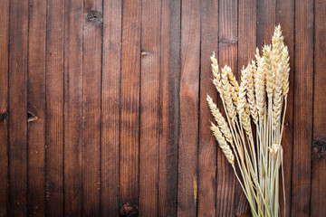 Wheat, oats, millet, barley. On Wooden background. Top view.