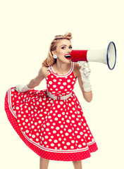 happy woman holding megaphone, dressed in pin-up style red dress
