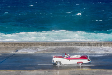 old american car riding at Malecon, Havana