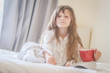 indoor portrait of young preteen girl at home
