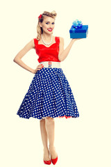 Woman in pin-up style dress with gift box