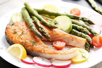 Steak of salmon with asparagus and vegetables