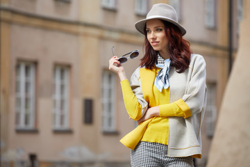 Beautiful brunette woman in chic fashion