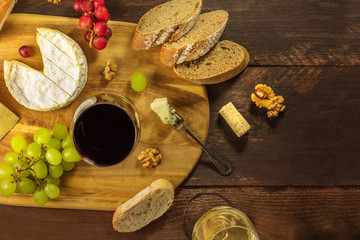 Cheese, bread and grapes at wine tasting