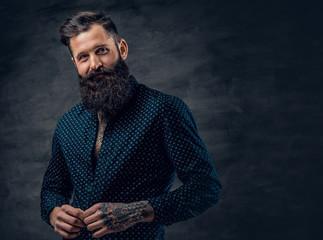 3dcad50dd09 Bearded tattooed male dressed in dark blue jacket.