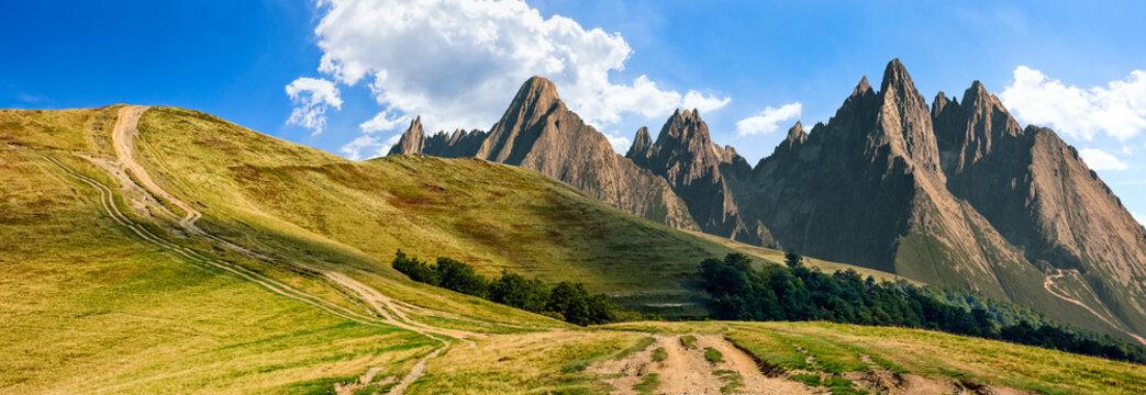 path through the mountain ridge with rocky peaks