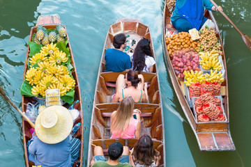 Tourists visiting by boat at Damnoen Saduak floating market in Ratchaburi near Bangkok, Thailand